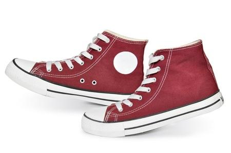 escarpines: Par de zapatillas nuevas de color rojo sobre fondo blanco Foto de archivo
