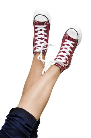 unleash: legs shod in Red Sneakers over white background Stock Photo