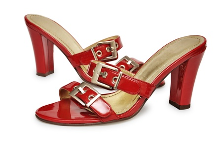 Pair of high heel red female shoes isolated on white background photo