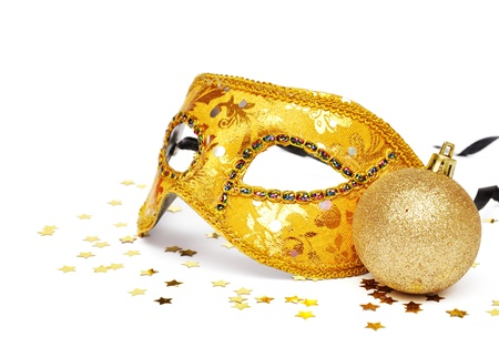 carnival golden mask with confetti on white background photo