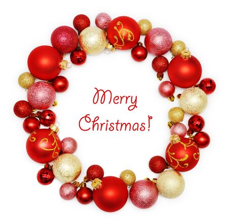 Christmas wreath decoration from red and golden color baubles on white background photo