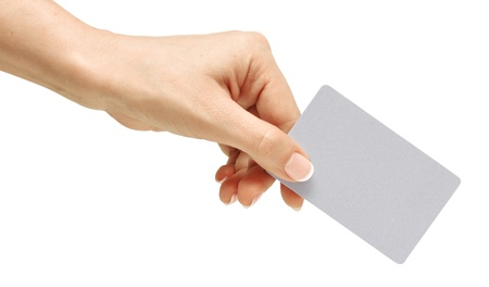 Business card in female hand. Studio isolated. With clipping path Stock Photo