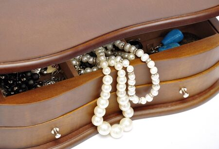 string of pearls: Peals in the wooden jewelry box close up