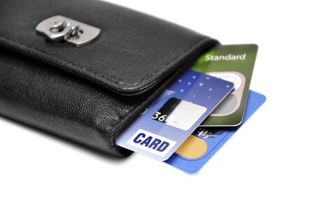 Black Wallet with credit cards over white background photo