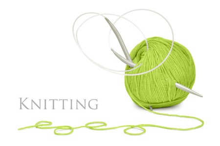 knitting needles: ball of green wool and knitting needles isolated on a white background