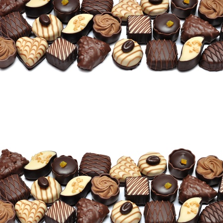 praline: Border of Different chocolate candies over white background