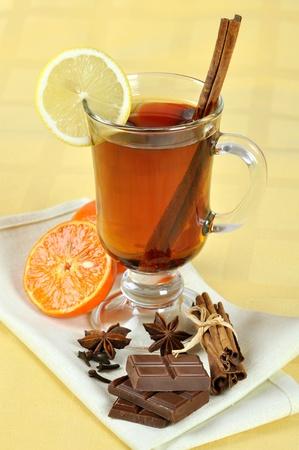 Mulled wine with chocolate, cinnamon, anise, lemon and orange photo