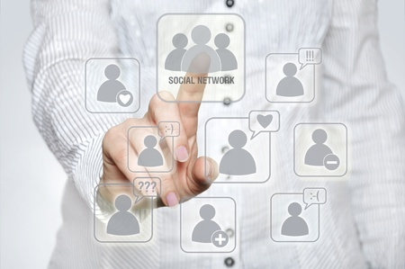 Woman pressing social network button with one hand Stock Photo - 12165587