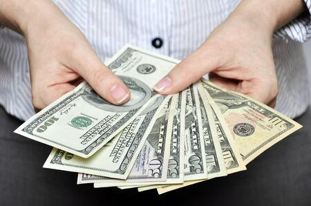 exchanging: Money in female hands closeup, sallow DOF