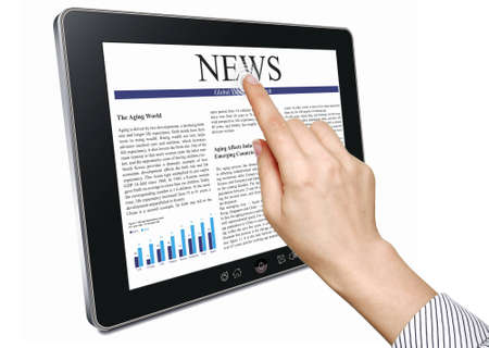 Female hands are pointing on touch screen device with business news Stock Photo - 12657477