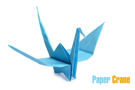 crane bird: Traditional Japanese origami crane made from blue paper over white background Stock Photo