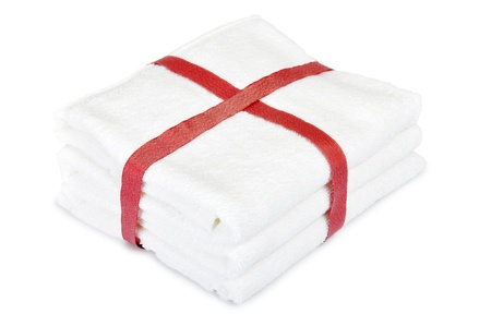white towels: White towels stack with red ribbon over white background