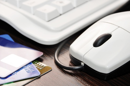 keyboard, mouse, credit card on the table closeup Stock Photo - 13010230