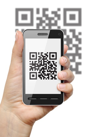 Scanning QR code with mobile phone on white background photo
