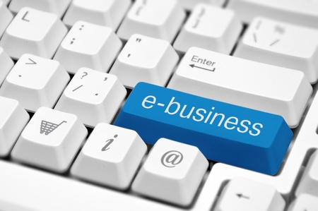 ebusiness: e-business key on a white keyboard closeup  E-business concept image  Stock Photo