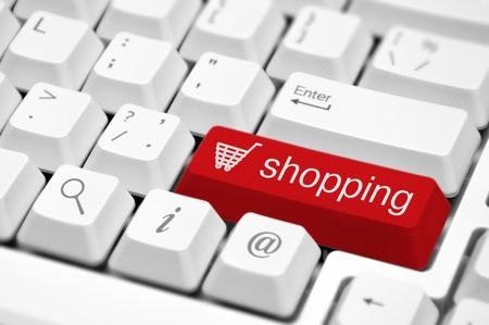online: Shopping cart icon button on the key of a computer keyboard