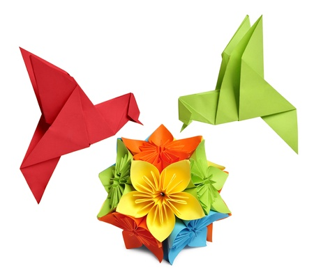 origami bird: origami humming-bird over flower kusudama over white background