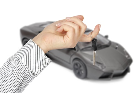 Car and hand with keys isolated on white background photo