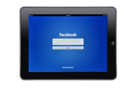 Apple iPad editorial studio shot with facebook app on screen