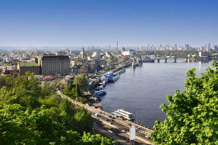 Kiev the capital of Ukraine, city landscape on river, bridge, and buildings