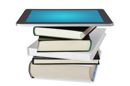 magazine stack: tablet pc e-book set upon a book stack isolated on white background