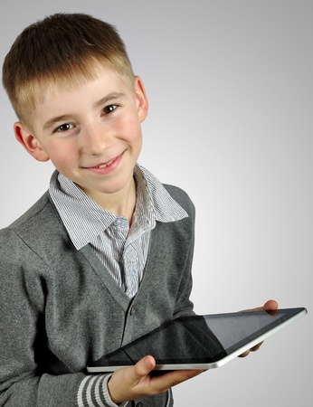 Portrait of a cheerful boy using a tablet computer photo