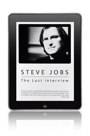 KIEV, UKRAINE - MAY 21, 2012: Photo of a Apple iPad device,showing the poster to documentary film about Steve Jobs (co-founder of Apple Computer) Steve Jobs. Lost interview that will be released in cinemas on May, 25th 2012