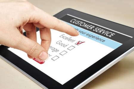 questionnaire: Online customer service satisfaction survey on a digital tablet