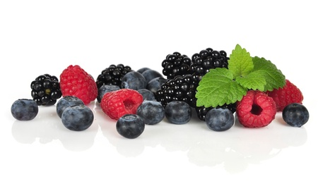 fresh blueberry, raspberry and blackberry isolated on white background Фото со стока