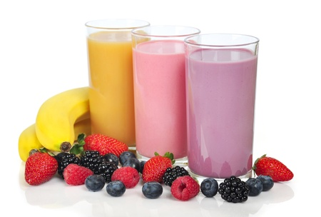 Three glasses of  smoothies with different berries and bananas photo