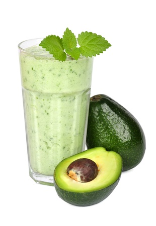 velvety: Avocado smoothie isolated on white background