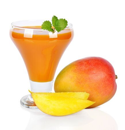 mango juice in a glass over white background. photo