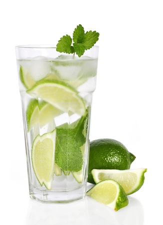 Glass of cocktail with lime and mint isolated on white photo