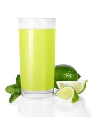 Glass of lime juice and mint isolated on white photo
