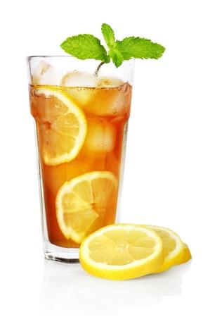 ice lemon tea: glass of ice tea with lemon and mint on white background