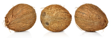 Three coconuts isolated on white background photo