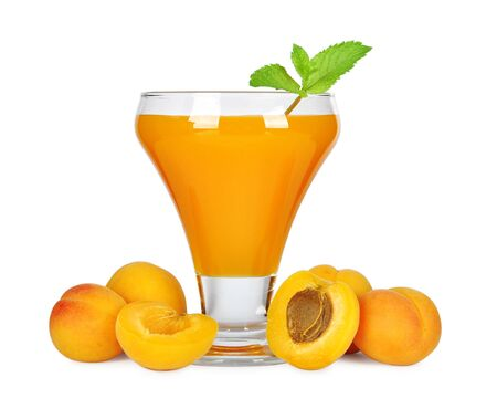Apricot juice in glass isolated on white background photo
