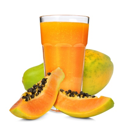 Glass of papaya smoothie isolated on white photo