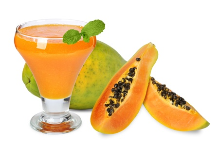 Fresh blended papaya juice with a mint leaf over white background