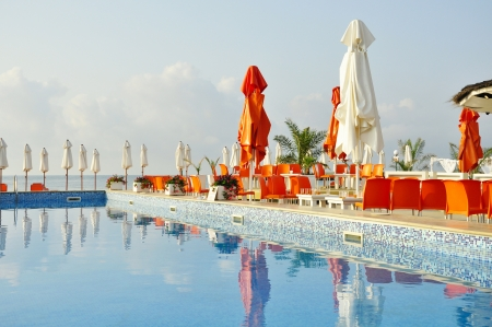 pool bars: Early morning in empty cafe by the pool on the beach in Bulgaria