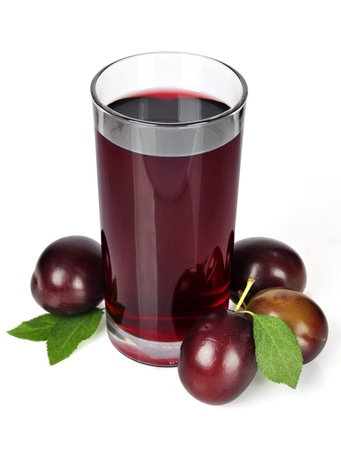 Fresh plums and a glass full of plums juice on a white background photo