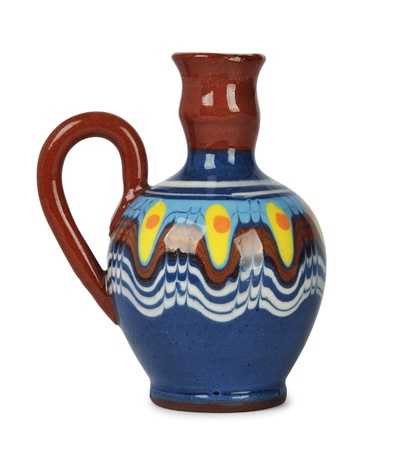 Ceramic crock with traditional bulgarian ornament isolated on white backgraund. Bulgarian souvenir. photo