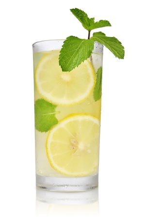 Drink with lemon, ice and mint isolated on white background photo