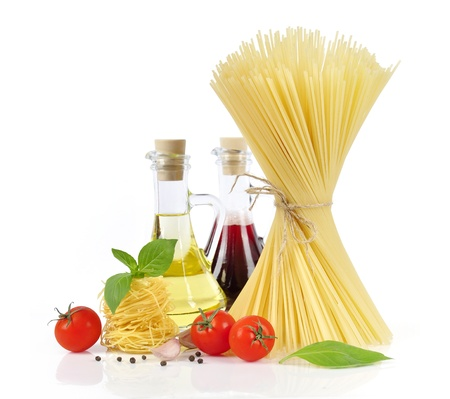 Italian Pasta with tomatoes, olive oil and basil on a white background  photo