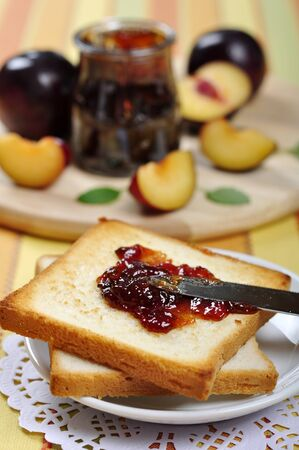 coffee jelly: Plum jam with toast on white plate and fresh ripe plums