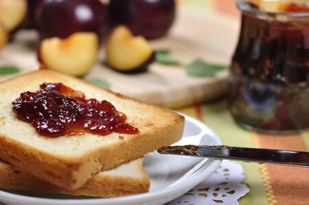 coffee jelly: Plum jam with toast on white plate and fresh ripe plums  Small shallow dof  Stock Photo