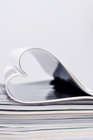 Selective focus image of magazine folded into a heart shape  Small shallow dof   photo
