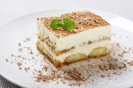 Tiramisu - Classical Dessert with Coffee on white plate  Garnished with Mint  Stock Photo - 16209230