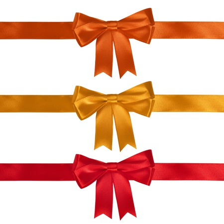 Set of ribbon bows - red, yellow, orange on white background. Clipping path for each bow included. Stock Photo
