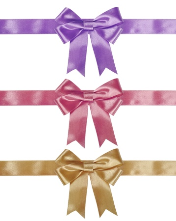 Set of ribbon bows - gold, pink, violet on white background. Clipping path for each bow included. photo
